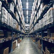 warehouse with storage boxes - plex demandcaster